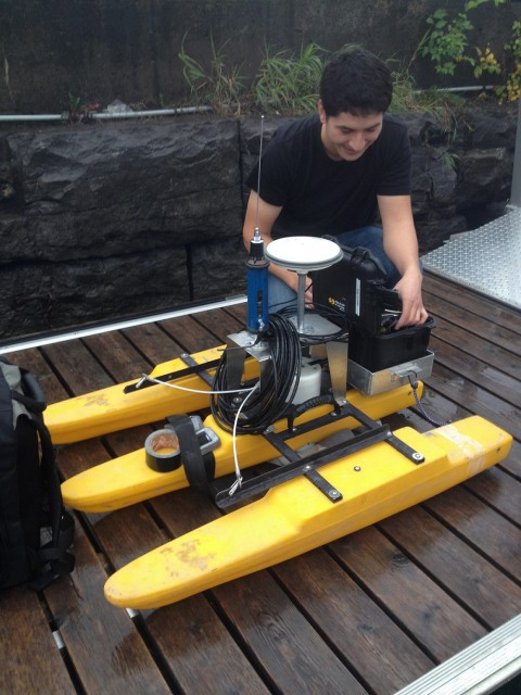 Sean Ferguson, an engineeing Masters student from the University of Ottawa, prepares the acoustic Doppler current profiler (aDcp) for a day in the field.  The aDcp unit records depth of the area as well as current and flow rates.