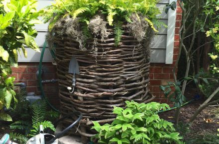 A Wicker Idea @ http://thegraciousposse.com/2015/05/disguise-a-rain-barrel-and-think-pink-live-green