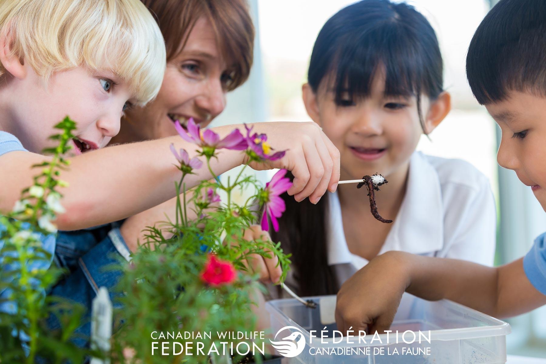 Teacher with kids gardening