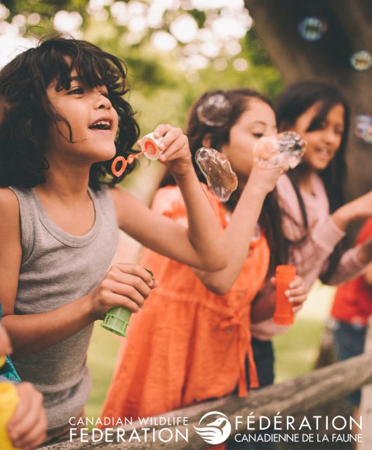 kids outside playing bubbles