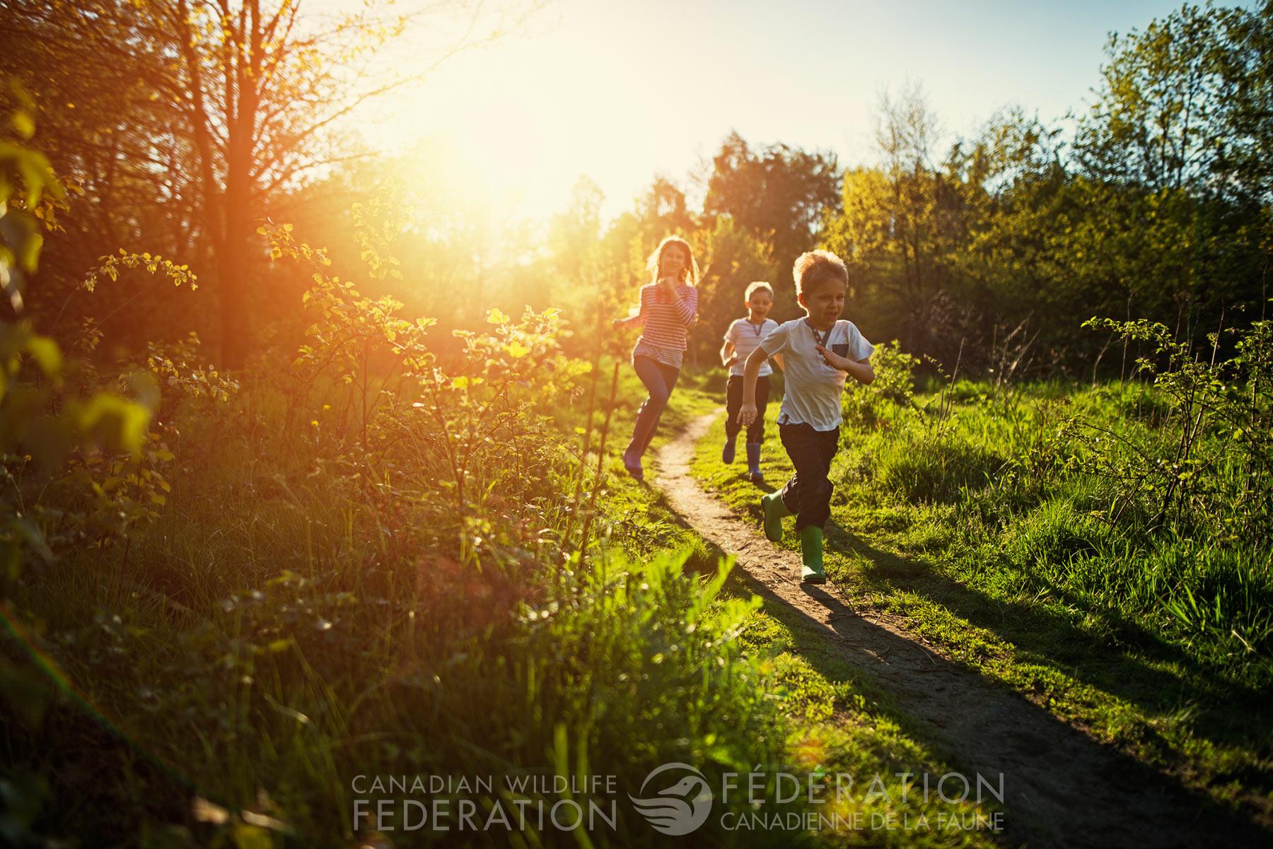 kids running outside dusk field