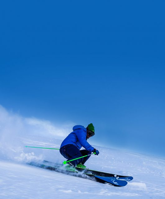 downhill skiier snow