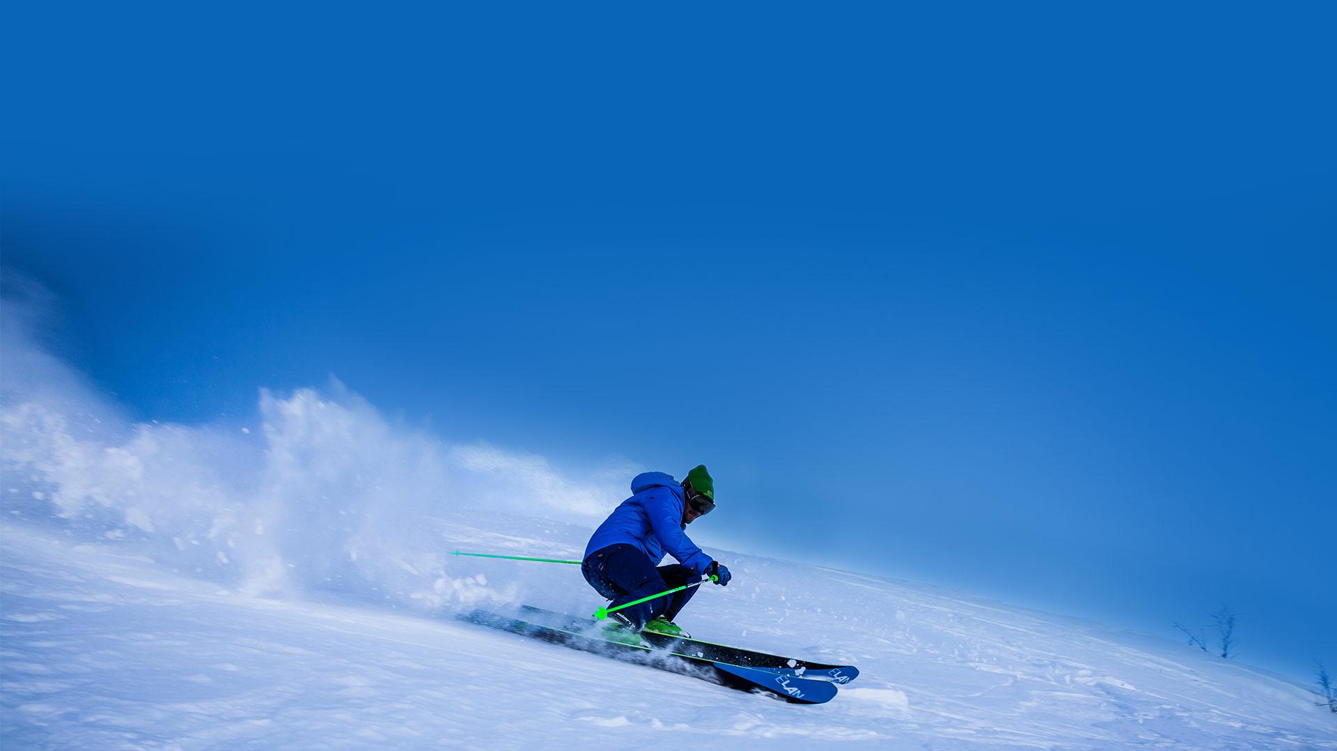 downhill skiier snow