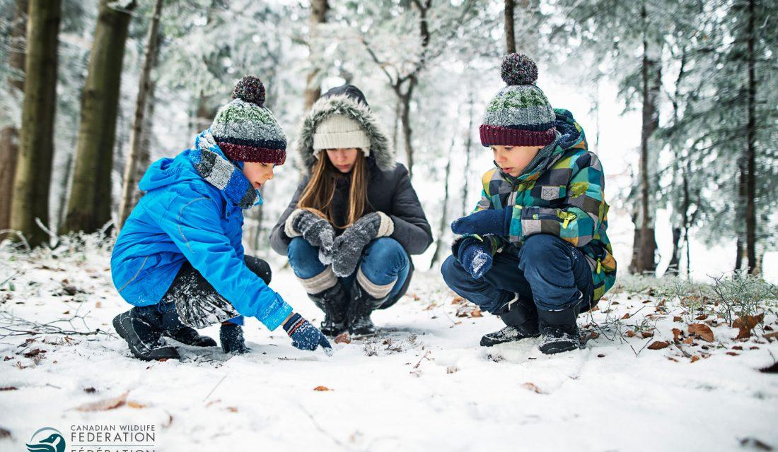kids following snow tracks