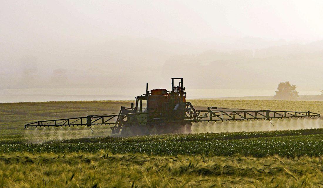 spraying a field farm