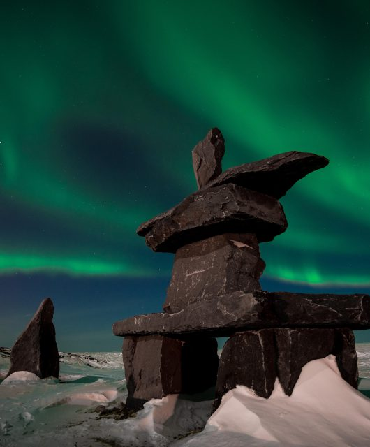 Northern Lights and the Inukshuk by Shafik Diwan