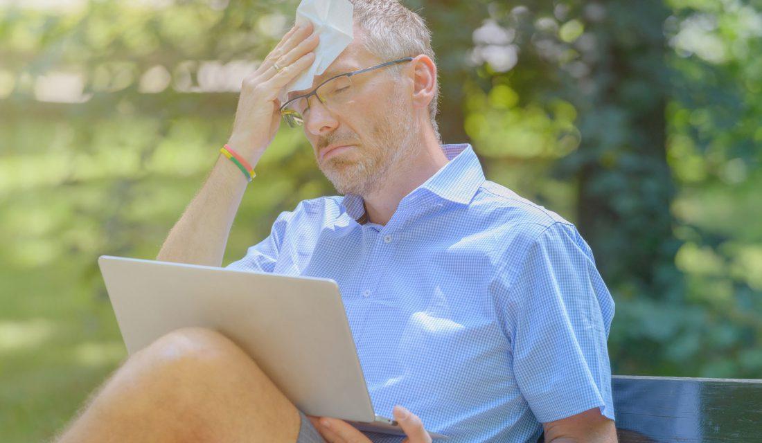 man sweating in sun