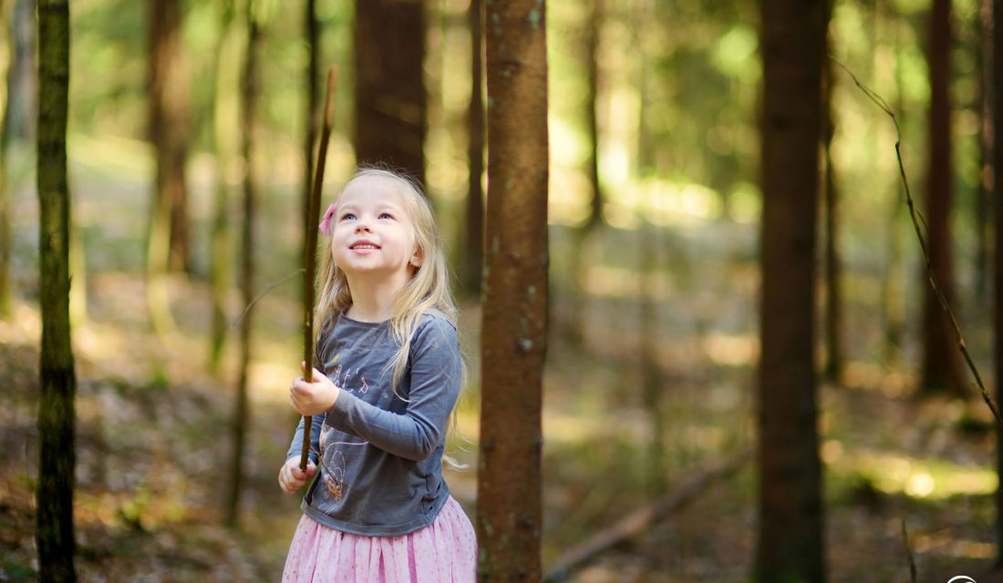 girl outside forest exploring