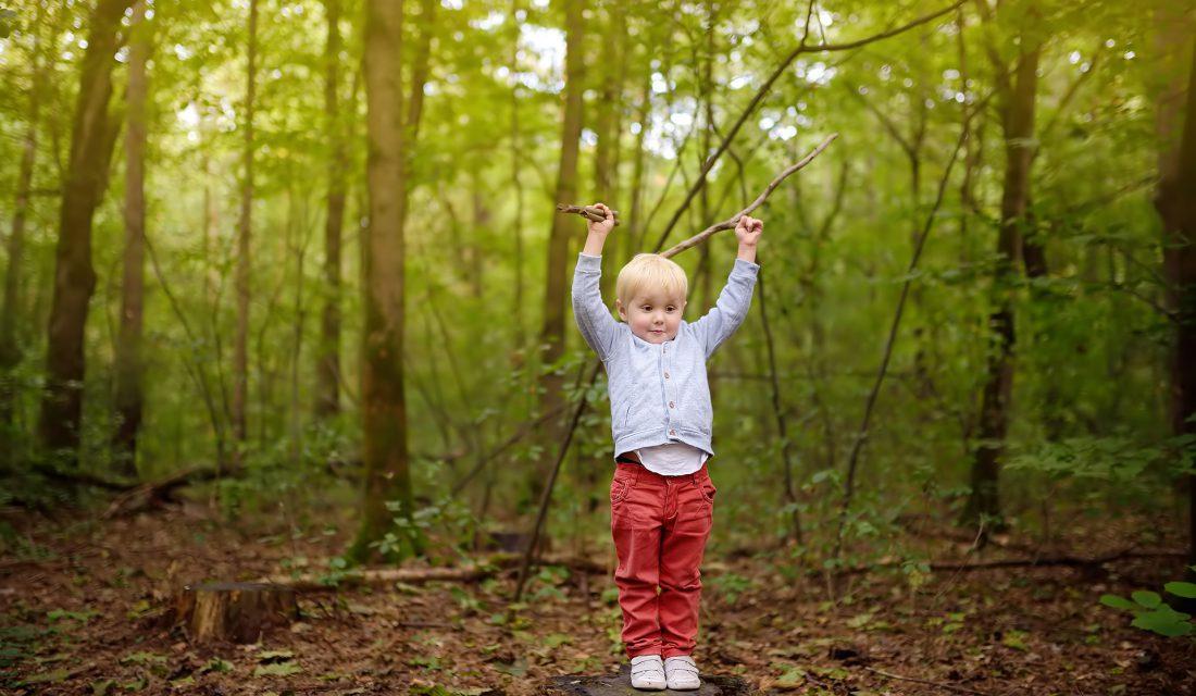 boy outside forest