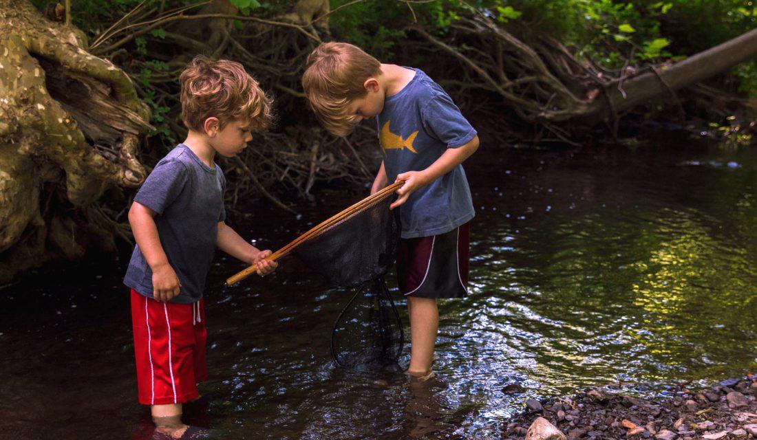 boys playin in creek
