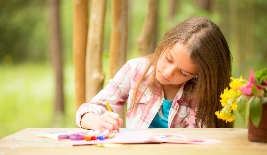girl colouring outside