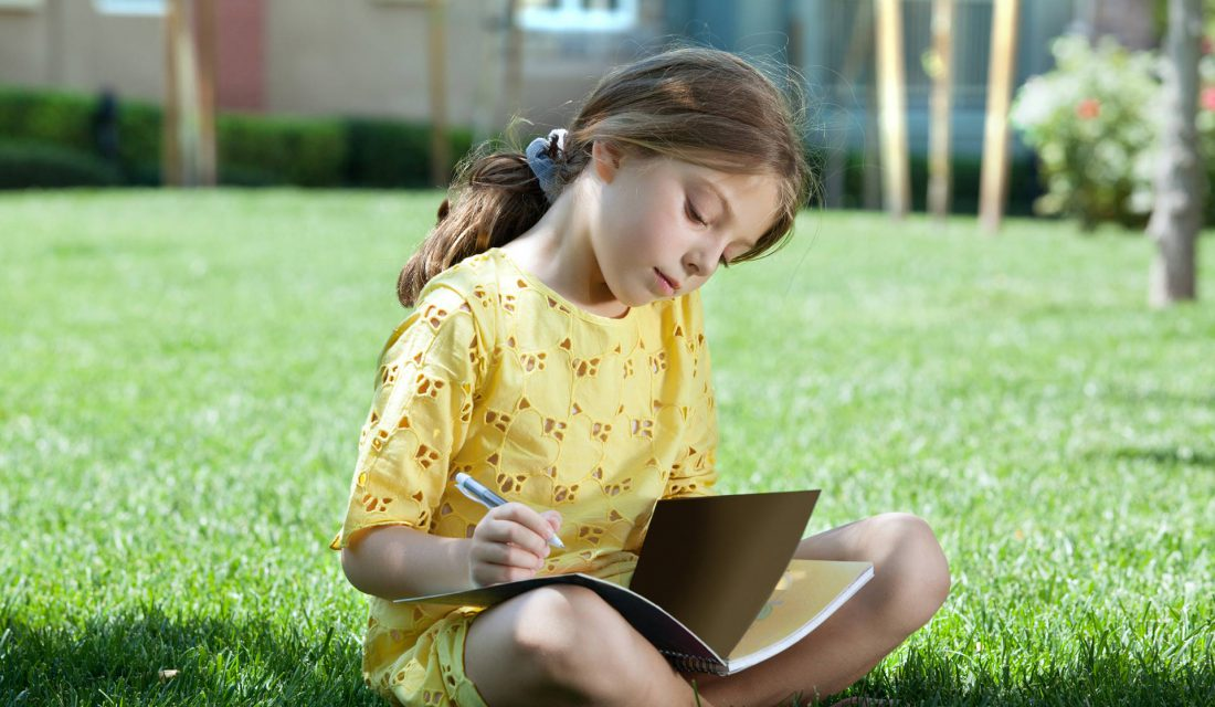 child journaling outside